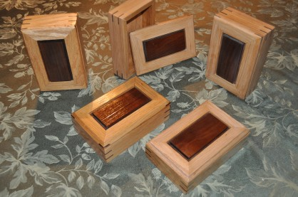 Small curio boxes. Red Oak sides, BlackWalnut inset tops and splines.