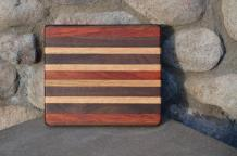 "# 14-08. Padauk, Black Walnut, Hard Maple and Red Oak. 8"" x 10"" x 3/4""."
