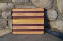 "# 14-22. Red Oak, Purpleheart and Yellowheart. 8"" x 10"" x 3/4""."
