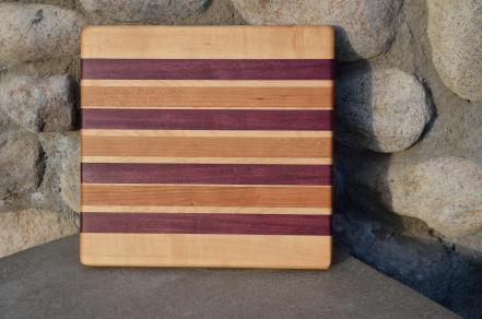 "# 14-13. Hard Maple, Purpleheart and Cherry. 8"" x 11"" x 1""."