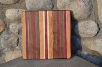 """# 14-14. Red Oak, Purpleheart, Black Walnut and Hard Maple. 8"""" x 10"""" x 1""""."""