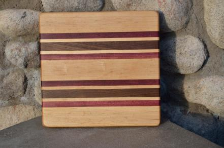 "# 14-16. Hard Maple, Purpleheart and Black Walnut. 8"" x 10"" x 3/4""."