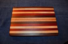 "# 14-23. Black Walnut, Hard Maple, Padauk, Red Oak and Cherry. 10"" x 12"" x 1""."