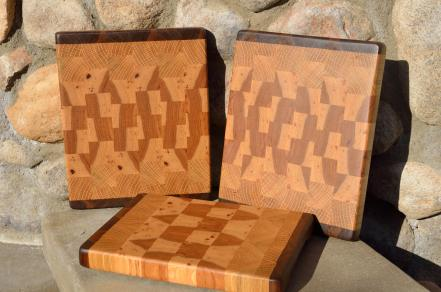 "# 14-22. Black Walnut, White Oak and Hickory. 8"" x 10"" x 1""."