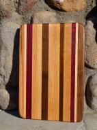 "# 14-25. Red Oak, Hard Maple, Purpleheart, Walnut and Yellowheart. 8"" x 10"" x 1""."