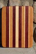 "# 14-26. Red Oak, Purpleheart and Hard Maple. 8"" x 10"" x 1""."