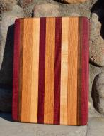 "# 14-27. Purpleheart, Black Walnut, Red Oak and Hard Maple. 8"" x 10"" x 1""."