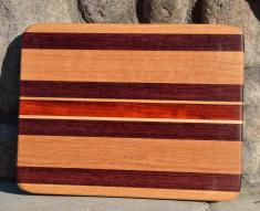 "# 14-28. Red Oak, Purpleheart, Hard Maple and Padauk. 8"" x 10"" x 3/4""."