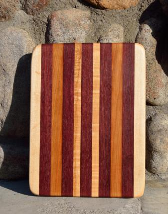 "# 14-29. Hard Maple, Purpleheart and Cherry. 8"" x 10"" x 1""."