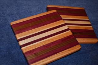"# 14-30. Red Oak, Purpleheart, Black Walnut and Hard Maple. 9"" x 11"" x 1""."