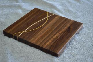 "# 14-31. Black Walnut with Yellowheart and Hard Maple inlay. 8"" x 11"" x 3/4""."