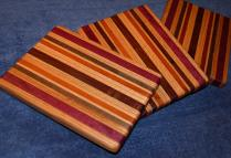 "# 14-33. Red Oak, Purpleheart, Black Walnut, Padauk and Hard Maple. 8"" x 10"" x 1""."