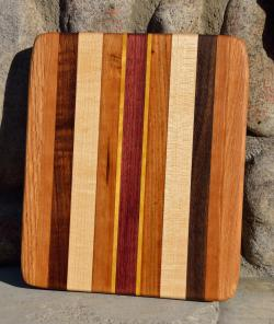 "# 14-35. Red Oak, Black Walnut, Hard Maple, Cherry, Yellowheart and Purpleheart. 9"" x 11"" x 1""."