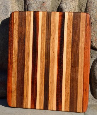 "# 14-36. Goncalo Alves, Red Oak, Black Walnut and Hard Maple. 8"" x 11"" x 1""."