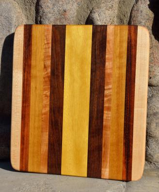 "# 14-37. Hard Maple, Goncalo Alves, Black Walnut and Yellowheart. 9"" x 11"" x 1""."
