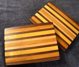 "# 14-38. Black Walnut, Teak, Yellowheart and Hard Maple. 8"" x 11"" x 1""."