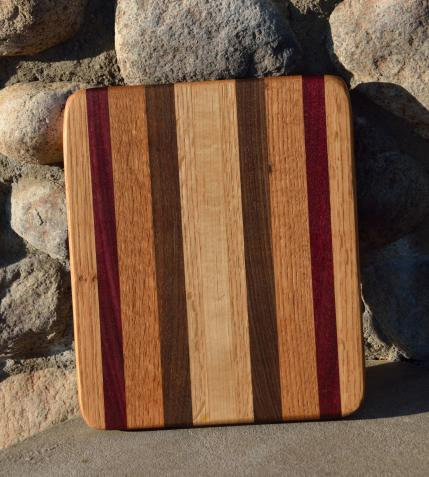 "# 14-40. Hard Maple, Purpleheart and Black Walnut. 8"" x 10"" x 1""."