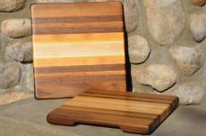"# 14-58. Black Walnut, Hard Maple, Yellowheart and Honey Locust. 11"" x 12"" x 1""."