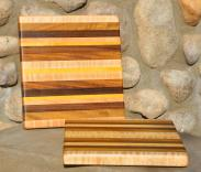 "# 14-63. Hard Maple, Teak, Yellowheart and Black Walnut. 9"" x 11"" x 1""."