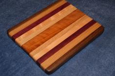"# 15-001. Black Walnut, Red Oak, Purpleheart, Hard Maple and Cherry. 11"" x 9"" x 1""."