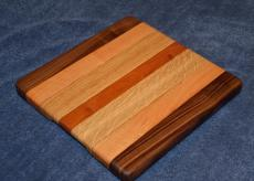 "# 15-002. Black Walnut, Hard Maple, Oak and Cherry. 11"" x 11"" x 1""."