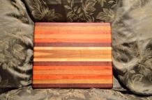 "# 13-02. Commissioned piece. Purpleheart, Padauk, Cherry, Hard Maple and Canarywood edge grain. 12"" x 16"" x 1-1/4""."