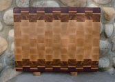 This end grain board has also been engraved on the back. The front is 100% useful as a great cutting boards. Woods are Purpleheart, Hard Maple & Canarywood.