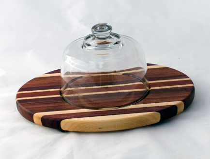 "Domed Cheese & Cracker Server 16 - 01. Jatoba, Bubinga, Bloodwood & Hard Maple. 10"" x 14"" x 1""."