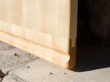 Detail of a cutting board destined for in-counter use, showing the typical slot that's routed to aid in pulling the board out of its slot in the kitchen cabinet. Each end gets a routed slot, but on opposite sides, so the slot is down and the board can get even, 2-sided use.