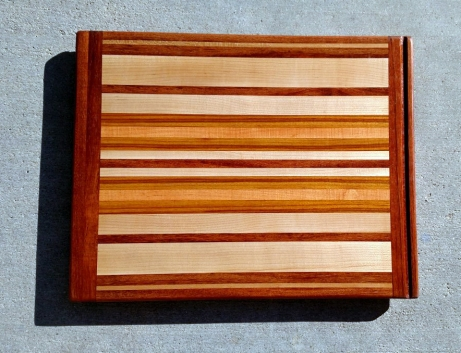 "Cutting Board 17 - 101. Jatoba, Hard Maple, Honey Locust, Cherry & Canarywood. 16"" x 22"" x 3/4""."