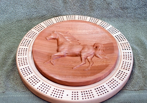 Cribbage 18 - 01. 4-player track. Hard Maple base with Cherry top featuring 3D carving. Lacquer finish.