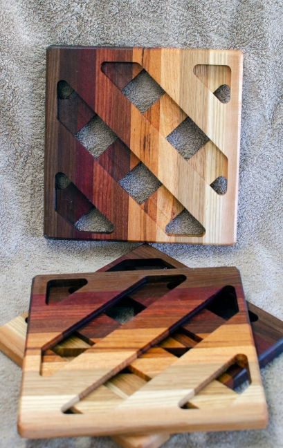 Trivet 18 -732. Black Walnut, Sapele, Bloodwood, Jarrah, Jatoba, Goncalo Alves, Honey Locust, Mesquite & Hard Maple.